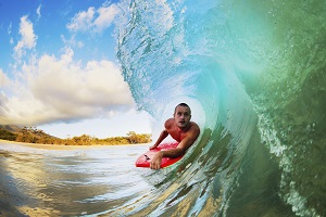 Try out surfing while staying at the Hilton Waikiki Beach Hotel