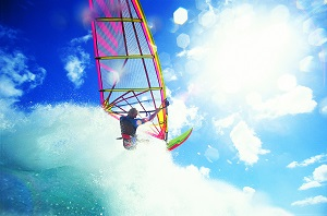 Try Windsurfing on one of Oahu's Beaches while staying at the Hilton Waikiki Beach Hotel